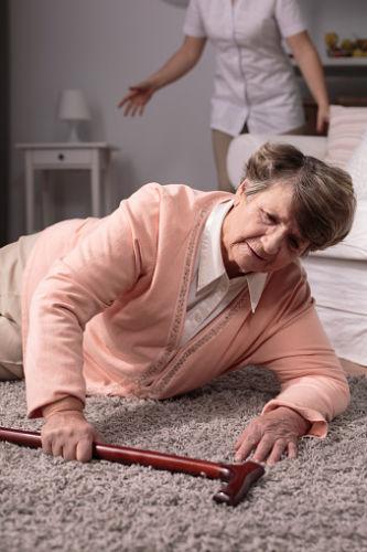 Nursing home fall: woman on floor
