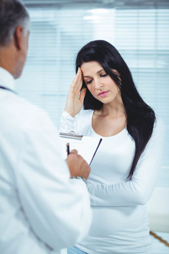 Woman with Cervical Cancer at Doctor Office