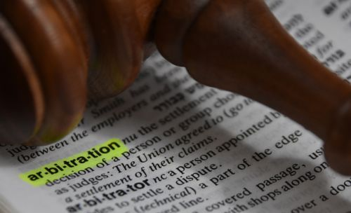Arbitration definition highlighted in a dictionary