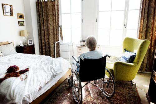 Senior woman sitting on a wheelchair