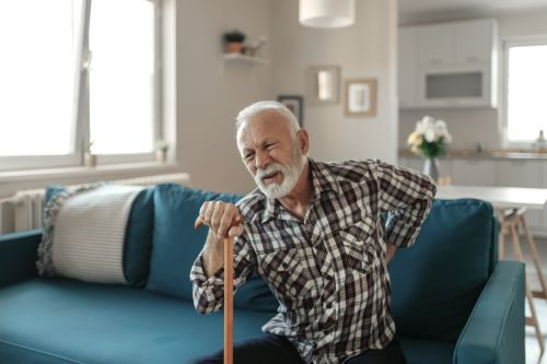 Senior man suffering from back pain.