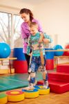 Child with cerebral palsy in physical therapy